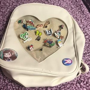 Lot of 17 disney pins and heart shape backpack